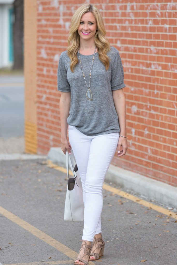 Pairing your white jeans with a striped button down and gray heels can make your white jeans office appropriate (depending on where you work of course.) I wore a bold striped shirt with contrasting cuffs so the outfit had a little more attitude.