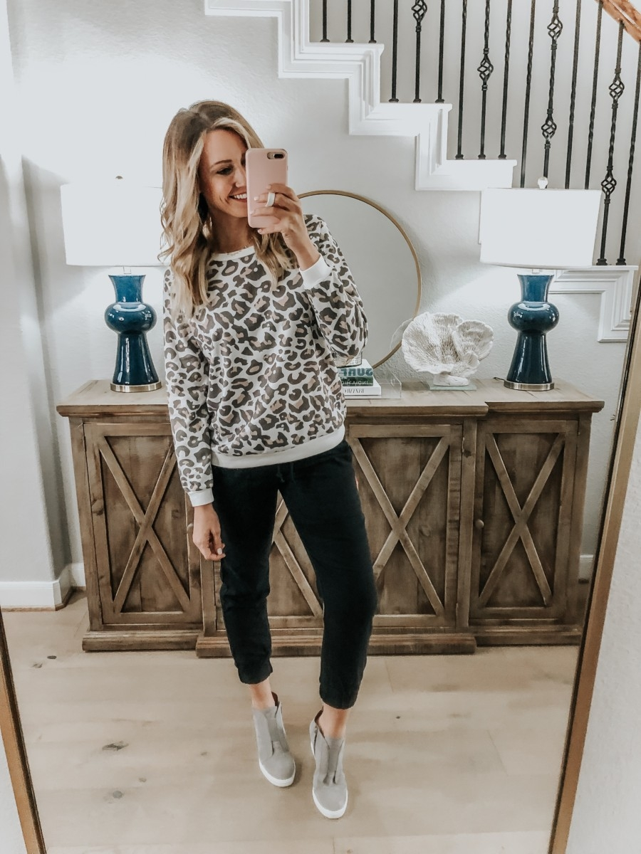 Amazon Favorites featured by top US fashion blog Haute & Humid; Image of a woman wearing Amazon leopard sweatshirt and black joggers.