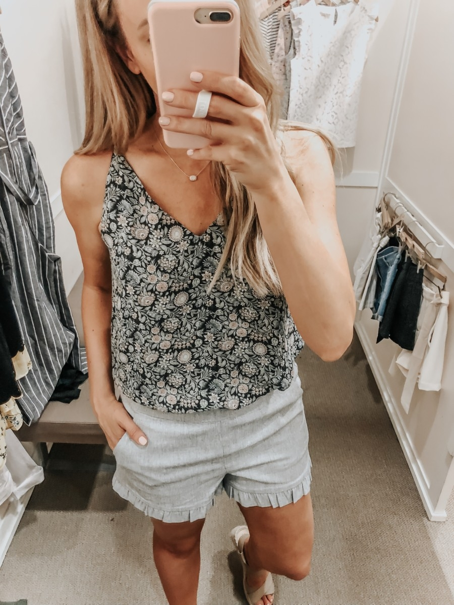 loft sale | LOFT Favorites: Spring Dressing Room Try-On Session featured by top US fashion blog, Haute & Humid; image of woman wearing a LOFT floral cami and ruffle trim shorts