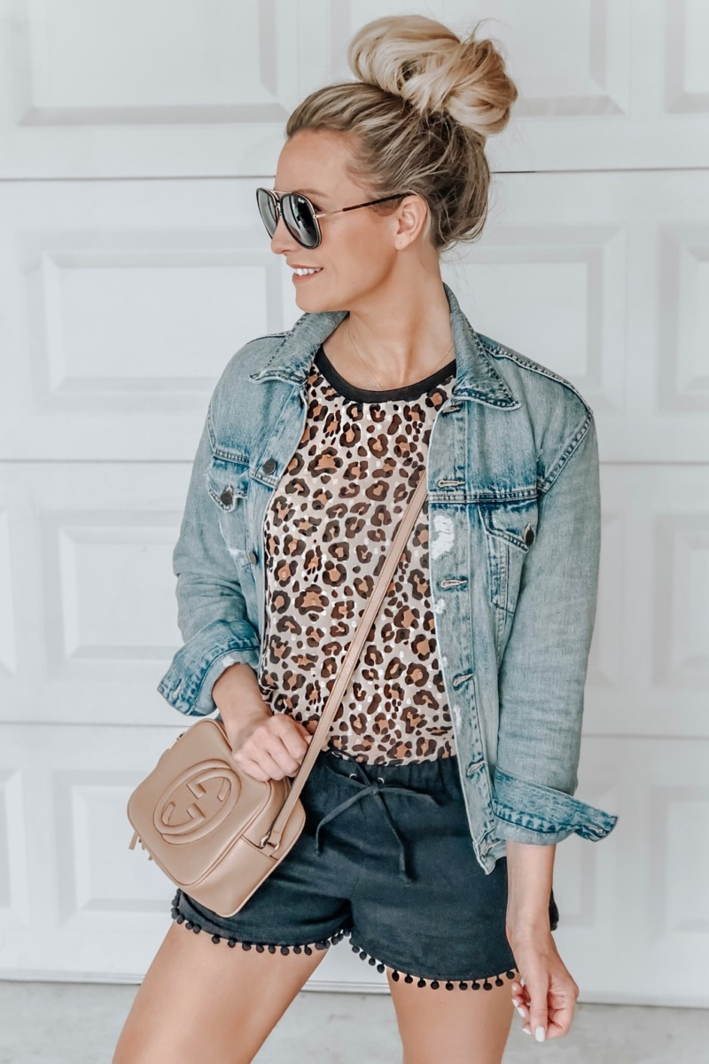Spring Favorites featured by top US fashion blog Haute & Humid; Image of a woman wearing Target top, J.Crew Factory pom-pom shorts, Able denim jacket and Gucci purse.