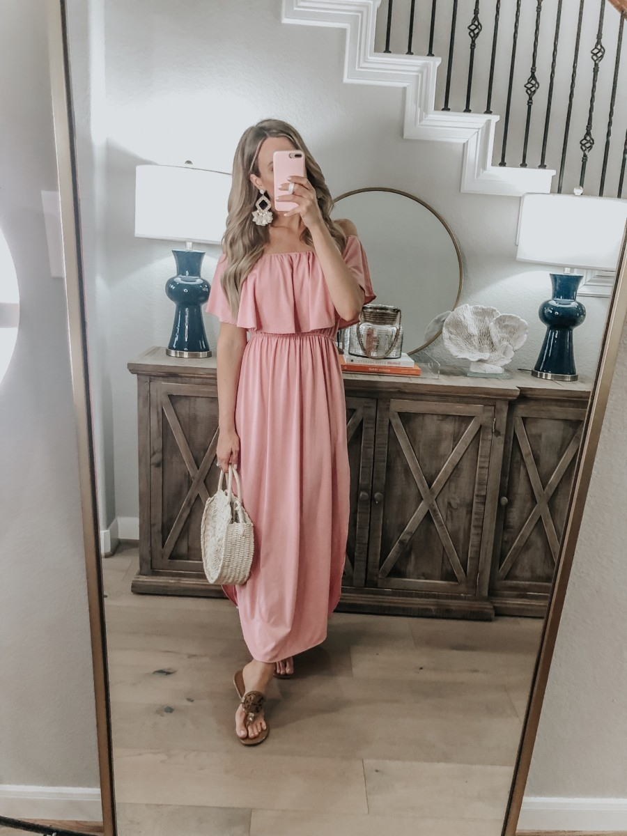 Spring Favorites featured by top US fashion blog Haute & Humid; Image of a woman wearing Amazon maxi dress, Tory Burch sandals, Walmart straw bag and Amazon earrings.