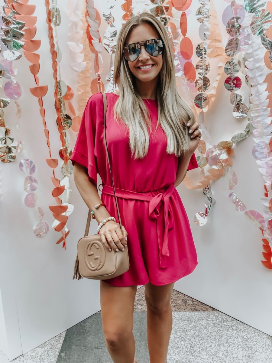 Spring Favorites featured by top US fashion blog Haute & Humid; Image of a woman wearing Red Dress pink romper and Gucci bag.