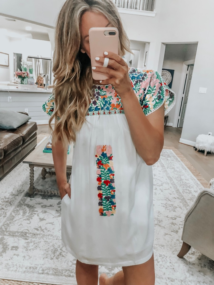 VICI Clothing featured by top US fashion blog Haute & Humid; Image of a woman wearing Vici mexican embroidered dress.