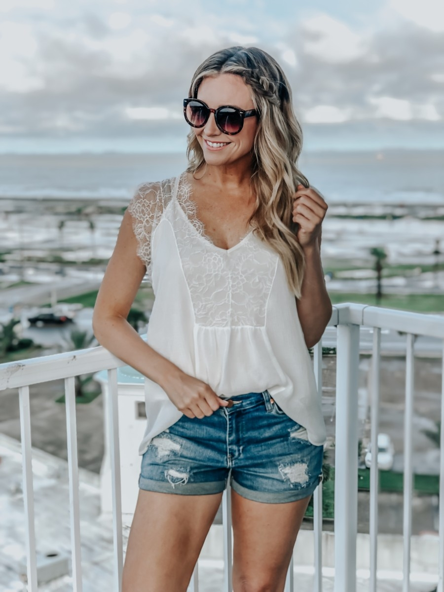 VICI Clothing featured by top US fashion blog Haute & Humid; Image of a woman wearing a VICI lace tank.