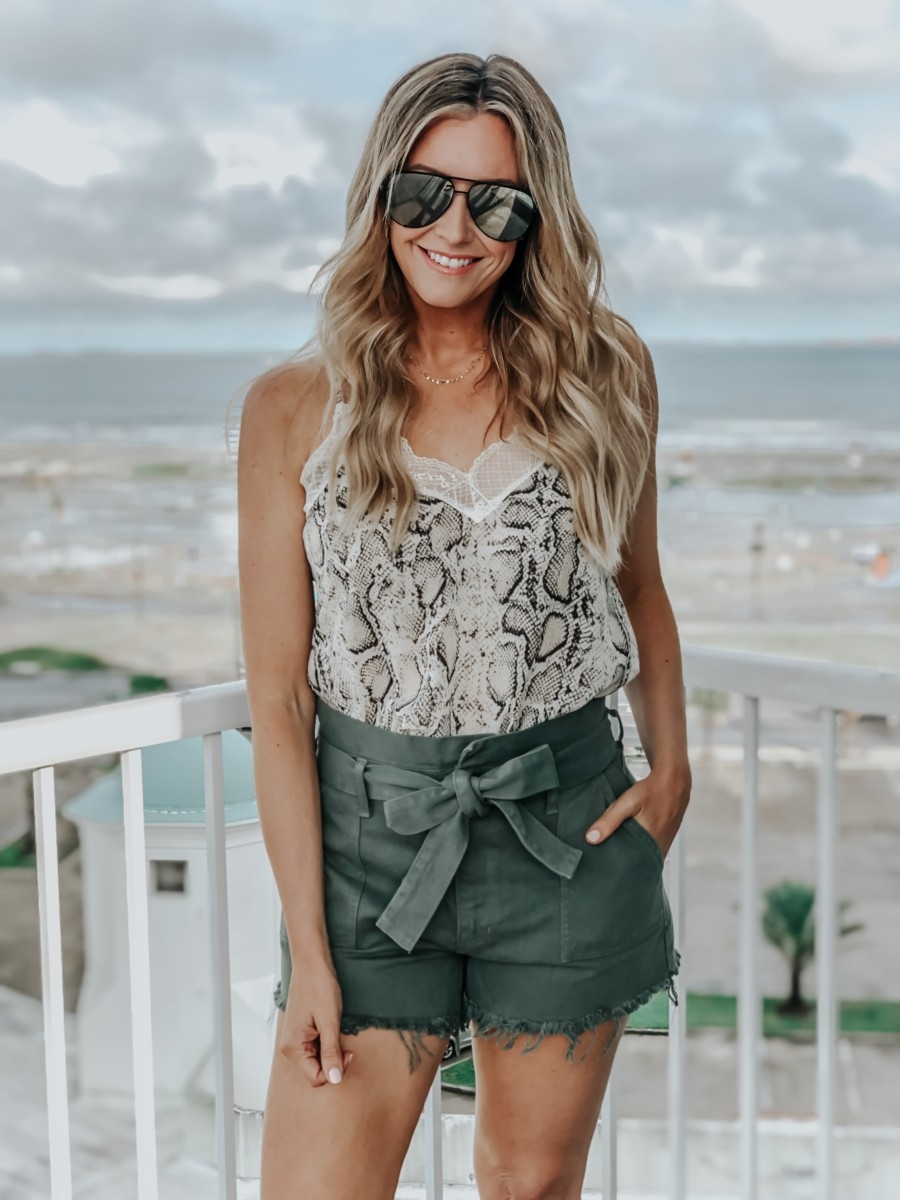 VICI Clothing featured by top US fashion blog Haute & Humid; Image of a woman wearing Vici tank and Vici paperbag shorts