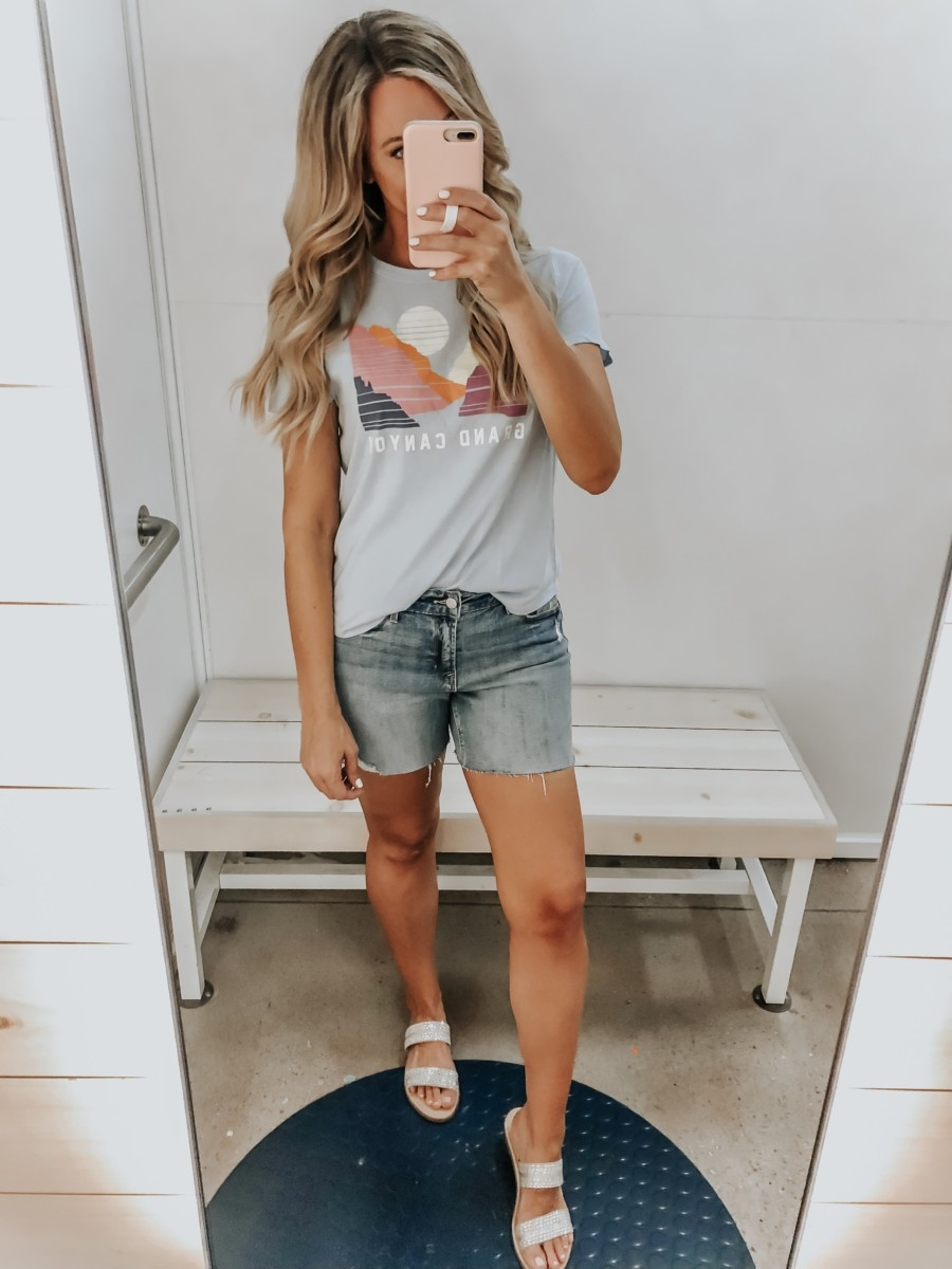 Best Memorial Day Weekend Sales featured by top US fashion blog Haute & Humid; Image of a woman wearing Old Navy graphic tee and Old Navy denim shorts.
