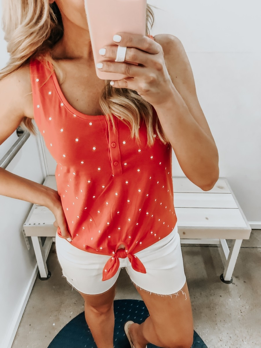Best Memorial Day Weekend Sales featured by top US fashion blog Haute & Humid; Image of a woman wearing Old Navy polkadot top.