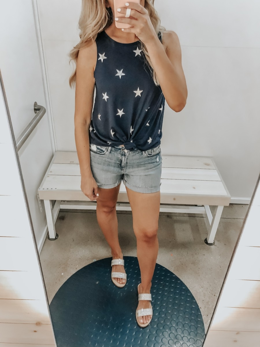 Best Memorial Day Weekend Sales featured by top US fashion blog Haute & Humid; Image of a woman wearing Old Navy star tank top and Old Navy shorts.