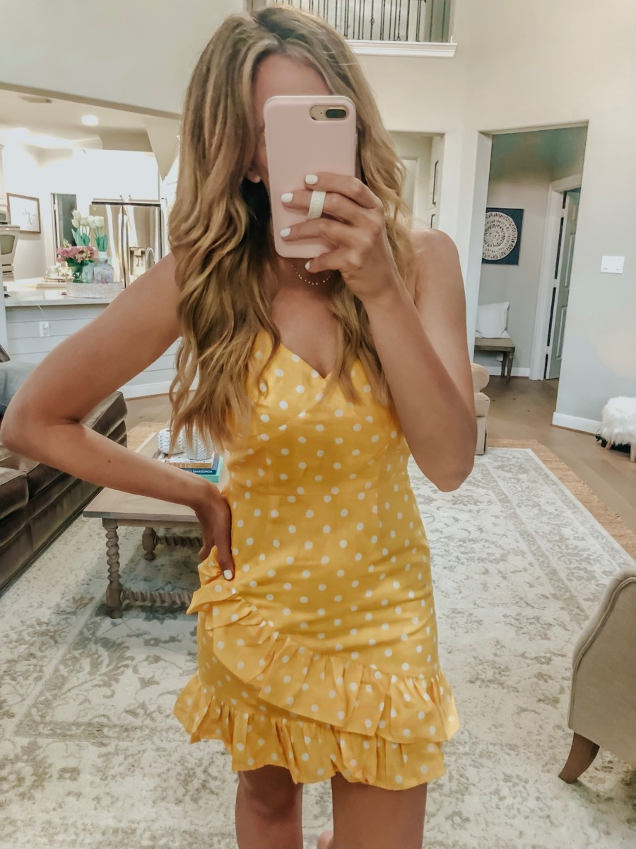VICI Clothing featured by top US fashion blog Haute & Humid; Image of a woman wearing Vici yellow polka dot dress.