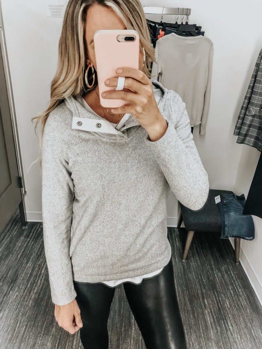 northface pullover | Nordstrom Anniversary Sale Early Access 2019- Best Of Basics by popular Houston fashion blog, Haute and Humid: image of a woman in a Nordstrom dressing room wearing a Knit Stitch Fleece Hoodie by THE NORTH FACE and Faux Leather Leggings by SPANX®