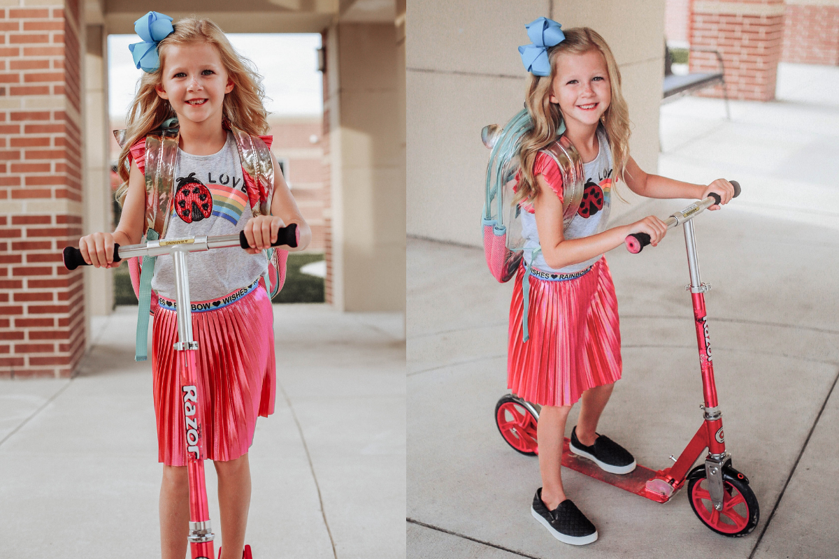 back to school girls outfit   Walmart Back To School Shopping by popular Florida fashion blog, Haute and Humid: image of a girl riding on her scooter in front of her school and wearing a Walmart 365 Kids From Garanimals Flutter Graphic Tank Top, 65 Kids From Garanimals Shimmer Foil Pleated Skirt, and Wonder Nation Solid and Printed Bike Shorts.