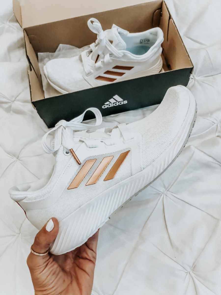 adidas swift run | Nordstrom Anniversary Sale Favorites by popular Houston fashion blog, Haute and Humid: image of woman holding white Edge Lux 3 Running Shoe by ADIDAS