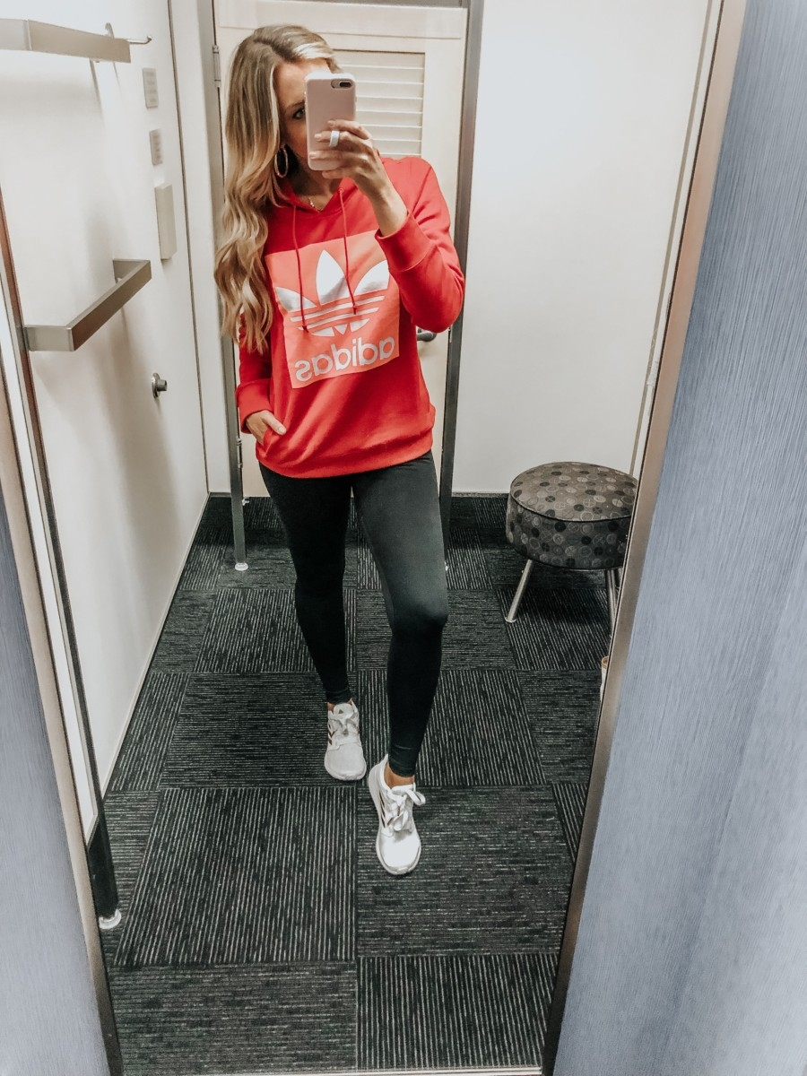 adidas hoodie | Nordstrom Anniversary Sale Favorites by popular Houston fashion blog, Haute and Humid: image of a woman in a dressing room wearing a Trefoil Hoodie by ADIDAS ORIGINALS, Live In High Waist Leggings by ZELLA, and white Edge Lux 3 Running Shoe by ADIDAS