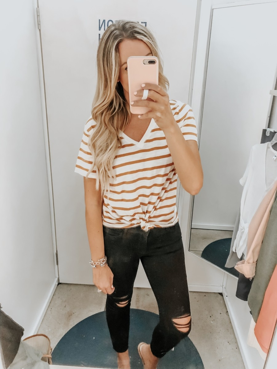 Old Navy Try On - August 2019 by popular Florida fashion blog, Haute and Humid: image of a woman standing in a Old Navy dressing room and wearing Old Navy High-Waisted Distressed Rockstar Super Skinny Jeans.