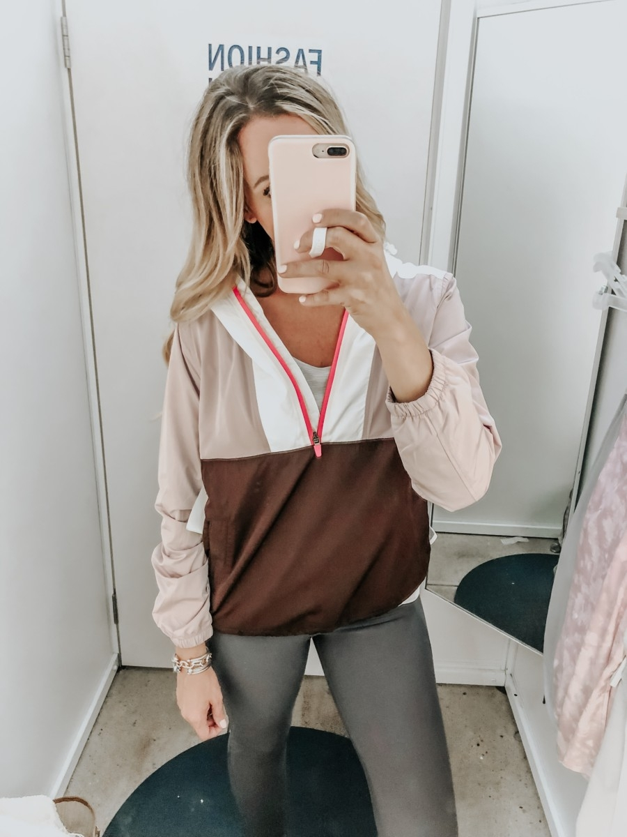 windbreaker | Old Navy Try On - August 2019 by popular Florida fashion blog, Haute and Humid: image of a woman standing in a Old Navy dressing room and wearing an Old Navy Go-H20 Water-Resistant Color-Blocked Anorak and High-Waisted Elevate Built-In Sculpt 7/8-Length Compression Leggings.