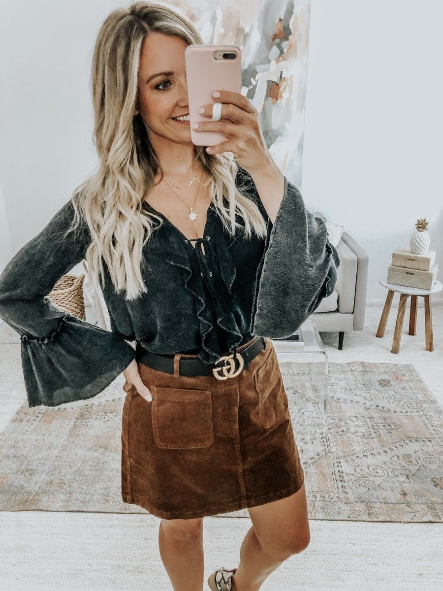 vici try on | 6 Early Fall Outfits With Vici by popular Houston fashion blog, Haute and Humid: image of a woman wearing a Vici Sparrow Lace Up Ruffle Top, Nordstrom BP Corduroy Miniskirt, Nordstrom Vince Camuto Gigietta Bootie, and Gucci Leather belt with Double G buckle.